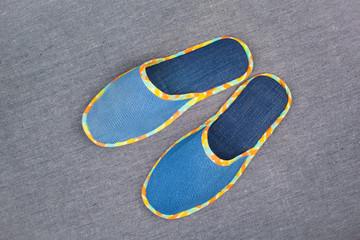 Denim slippers on the background of denim.