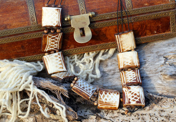 Ethnic handmade wooden necklace and old wooden chest