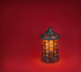 Glass lamp on a red background
