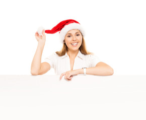 Teenage girl with a blank billboard and a Christmas hat