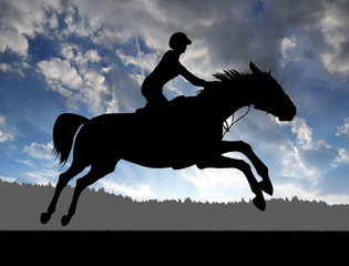 silhouette of a rider on a running horse at sunset
