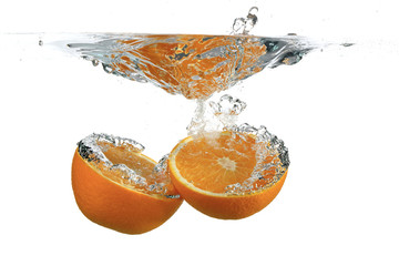 Divided orange in water