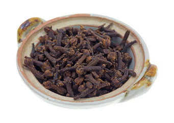 Whole cloves in a small bowl