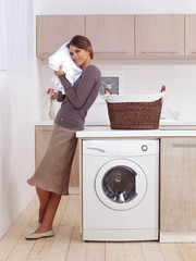 smiling woman in the laundry room