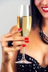 Close up of a elegant black hair woman drinking champagne.