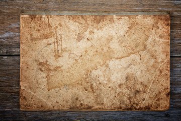 texture of an old writing-book on an old board