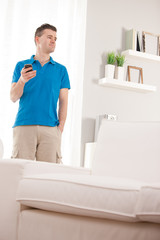 relaxed man having with a smart-phone
