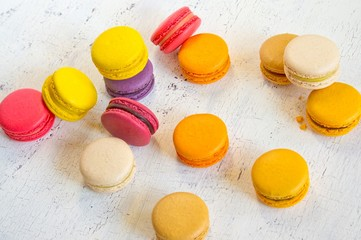 Traditional French colorful macaroons on a white table