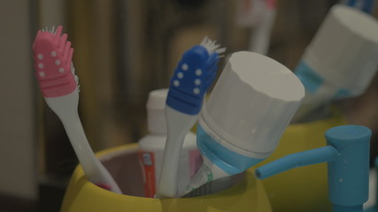 Colorful toothbrushes in a mug