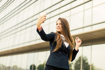 Young woman taking a selfi with mobile phone