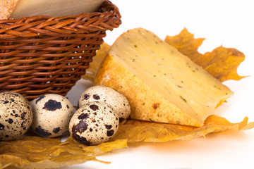 cheese allsorts in a wicker basket on yellow autumn leaves with