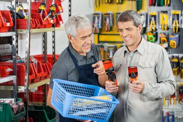 Salesman Assisting Customer In Buying Pliers