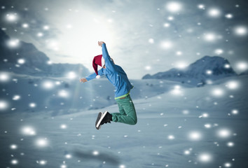 boy jumping in the snow
