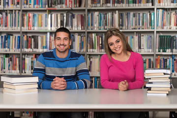 Portrait Of A Student Couple Studying At Library