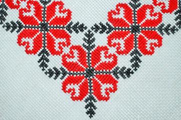 Cross stitch pattern on white cloth