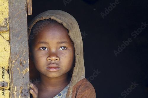 Leinwanddruck Bild Madagascar-shy and poor african girl with headkerchief