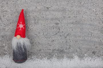 Nordic gnome on grey limestone background