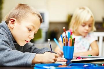 Siblings are doing his homework