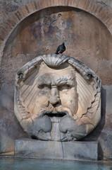 Mask Fountain at Santa Sabina in Rome