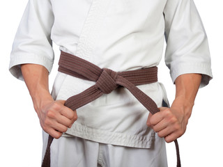 White kimono belt edge in hands