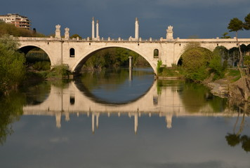 Reflections on the Tiber river, Rome, Italy. Flaminio bridge
