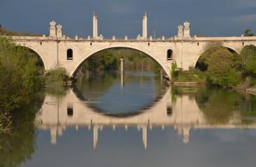 Reflections on the Tiber river, Rome, Italy. Flaminio bridge