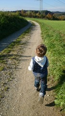 Boy running through nature