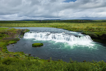 A small waterfall in the valley of Iceland