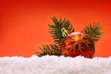 Red Christmas ball and snow.