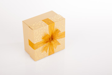 Golden gift box with golden bow