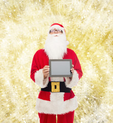 man in costume of santa claus with tablet pc
