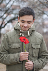 Shy teen with flower