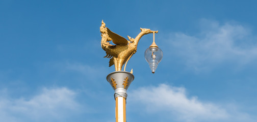 Golden swan lamp and wind bell in temple  thailand