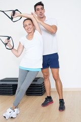 suspension training with coach and elder women