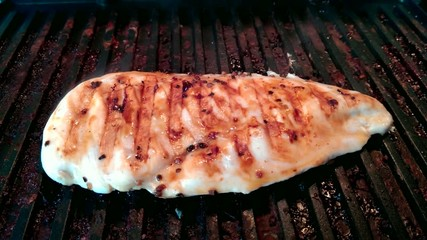 The chicken steak on the grill