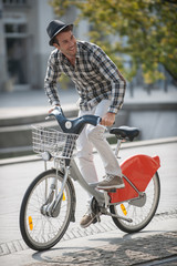 young man  riding a bicycle in the city
