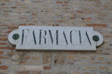 Farmacia, old pharmacy sign made of stone