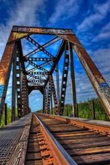 Weathered train trestle shows rust and graffiti
