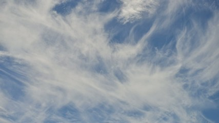 Puffy white clouds in a blue sky timelapse