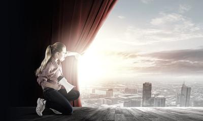 Girl opening curtain