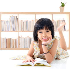 Cute asian girl reading a book