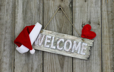 Christmas welcome sign with Santa Claus hat and red heart