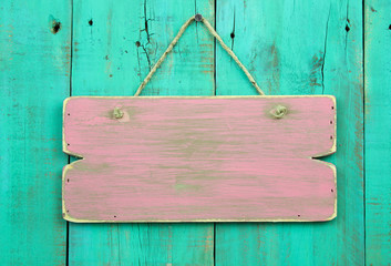 Blank wood pink sign hanging on rustic wooden background