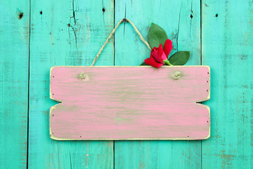 Blank wood pink sign with flower hanging on wooden background