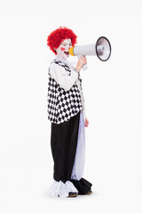 Clown in Red Wig and Makeup Using Megaphone.
