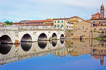 Historical roman Tiberius bridge over river in Rimini, Italy