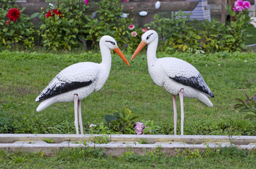 funny two white stork decorations in resort park