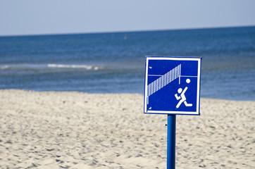 beach volleyball sign near sea