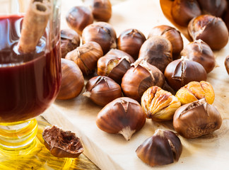 Delicious roasted chestnuts on wooden board