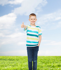 little boy in casual clothes with arms crossed